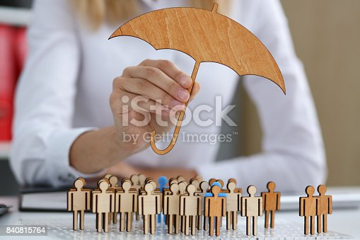 istock The female hand holds a miniature umbrella in the hand 840815764