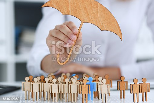 958039576 istock photo The female hand holds a miniature umbrella 871012382