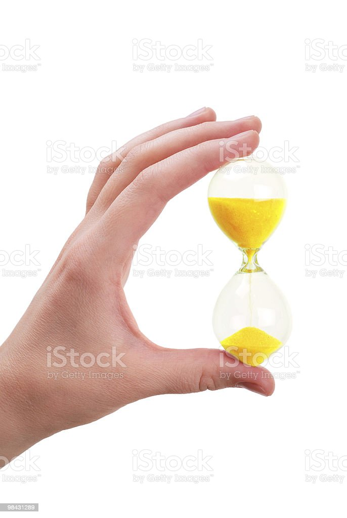 The female hand holds a sand-glass royalty-free stock photo