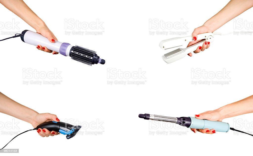 La mano femmina tiene сurling ferro foto stock royalty-free