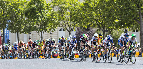 the feminine peloton in paris - sports event stock photos and pictures
