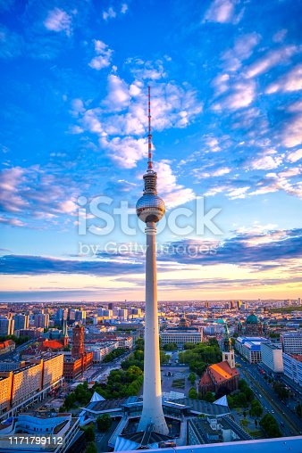 A view of the television tower (Fernsehturm) over the city of Berlin, Germany at sunset.