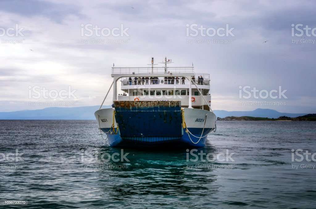 OURANOUPOLI, GREECE - MARCH 27, 2017:The ferry is arriving in Ouranopoli, Mount Athos, Greece stock photo
