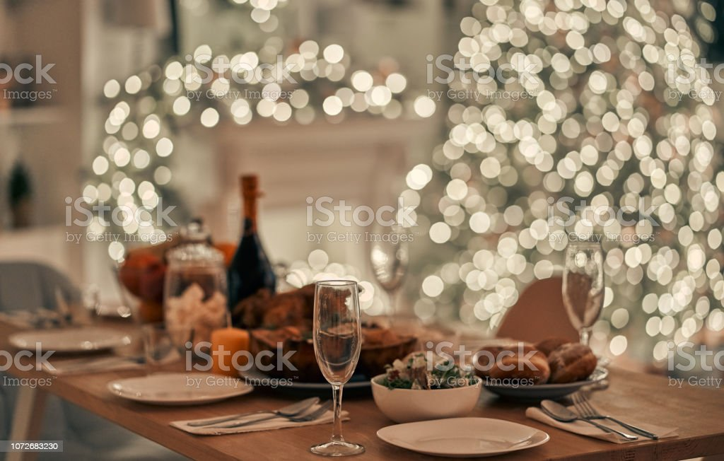 The festive table on the christmas tree background - Foto stock royalty-free di Alchol