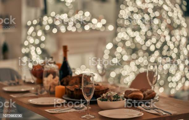 The Festive Table On The Christmas Tree Background - Fotografie stock e altre immagini di Alchol