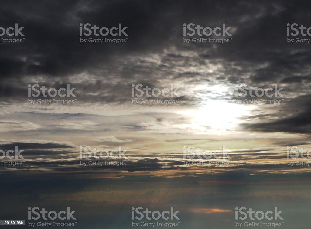The fiery orange sunrise sky backgound,Beautiful dramatic sunrise.The sun behind the clouds.Landscape.Toned photo. royalty-free stock photo