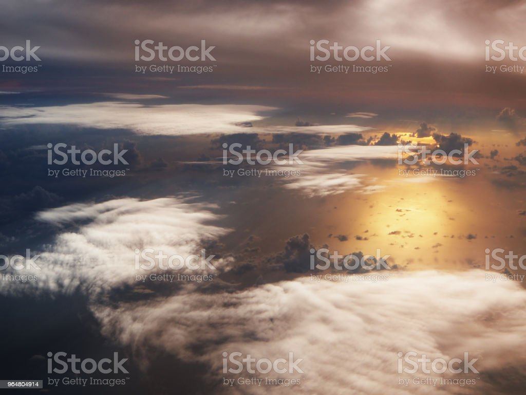 The fiery orange sunset sky backgound,Beautiful dramatic sunset,orange-violet sky.The sun behind the clouds.Landscape.Toned photo. royalty-free stock photo
