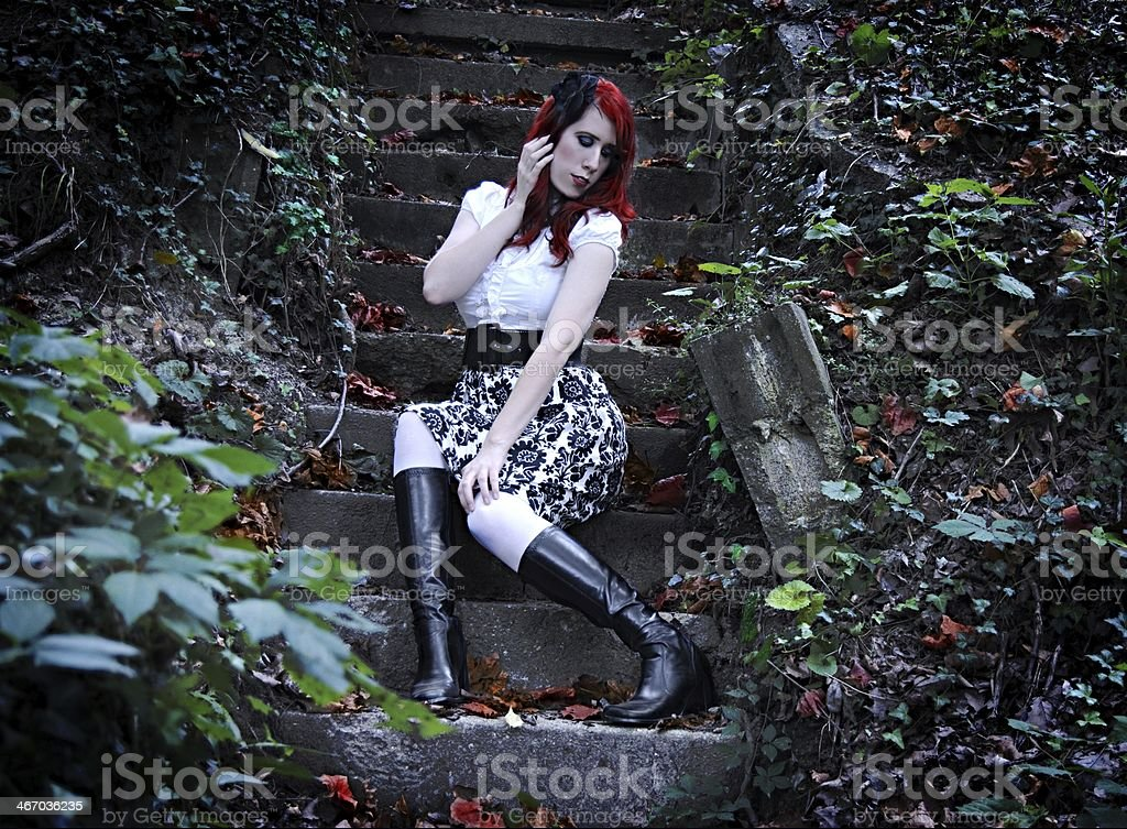 The fiery-haired girl stock photo