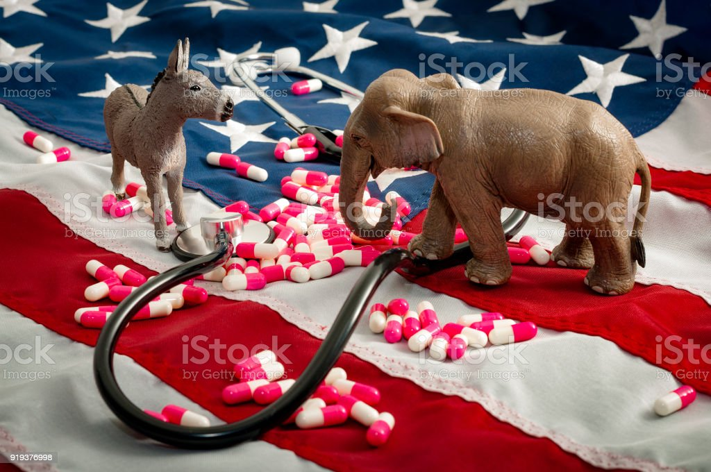 The fight over the Affordable Care Act and healtcare concept stock photo