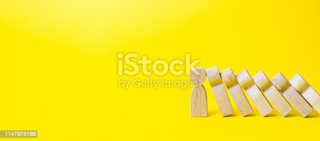 istock The figure of a person stops the fall of a set of figures like dominoes. business training, self-improvement, stress resistance. Colaps dominoes. Strong leader and reliable support and loyal. Banner 1147975186