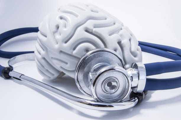 The figure of the human brain with a stethoscope or phonendoscope around him. Picture for medical neurological examinations or surveys The figure of the human brain with a stethoscope or phonendoscope around him. Picture for medical neurological examinations or surveys neurodegenerative disease stock pictures, royalty-free photos & images