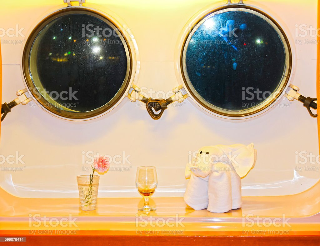 The figure of the towel against two windows in the stock photo