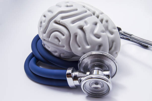 The figure on the brain is on twisted into a spiral tube of the stethoscope with chestpiece, which as it listens to the human brain. The idea for the diagnostic imaging in neurology and neuroscience stock photo