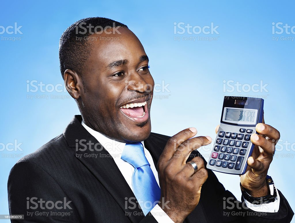 The figures look great! Happy businessman with calculator royalty-free stock photo