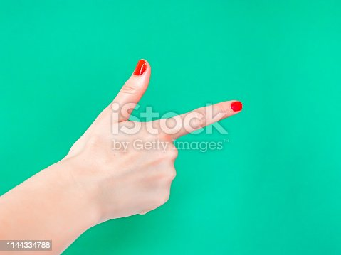 istock The Finger Gun Hand Sign. Is used as a way to say Yup with your hands. 1144334788