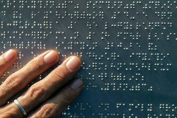 The fingers are touching the metal plate written in the Braille letters; helps the blind to recognize and communicate through the text. The fingers are touching the metal plate written in the Braille letters; helps the blind to recognize and communicate through the text. hunting blind stock pictures, royalty-free photos & images