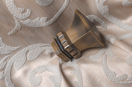 686515422 istock photo The finials for the curtain rods lies on the curtain fabric. 922767390