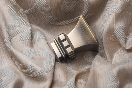 686515422 istock photo The finials for the curtain rods lies on the curtain fabric. 922768572