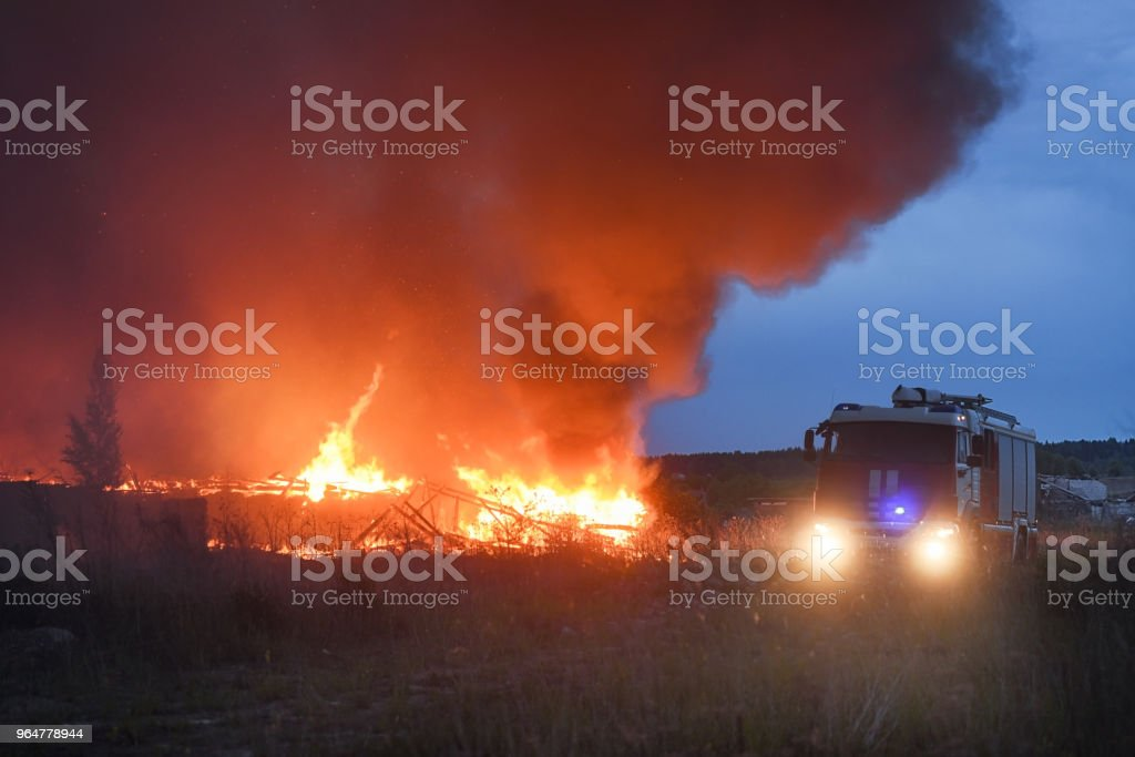 The fire in the village, people by cars escape from fire - the concept of disaster royalty-free stock photo