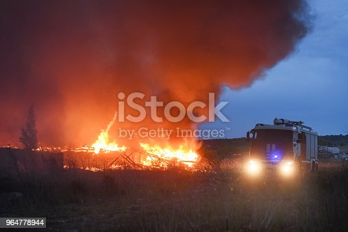 The Fire In The Village People By Cars Escape From Fire The Concept Of Disaster Stock Photo & More Pictures of Accidents and Disasters