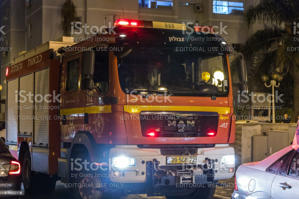 The Fire Truck Arrived At Night On An Emergency Call Is On