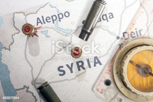 istock The fired case 9mm and Kalashnikov. View on map Syria. 635970554
