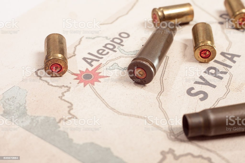 The fired case 9mm and Kalashnikov. View on map Syria. – zdjęcie