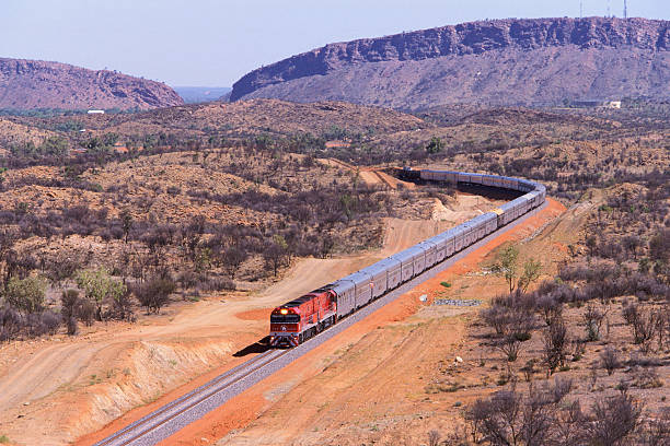 the first ghan train to darwin departs alice springs - darwin stock photos and pictures