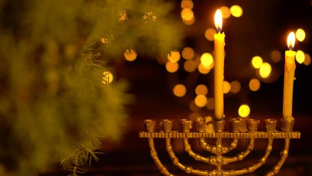 The First Night of Hanukkah. One light in the menorah Chanukah is the Jewish Festival of Lights hanukkah stock pictures, royalty-free photos & images