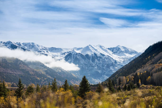 The first snow over the mountains beginning of the winter. Beautiful Autumn landscape stock photo