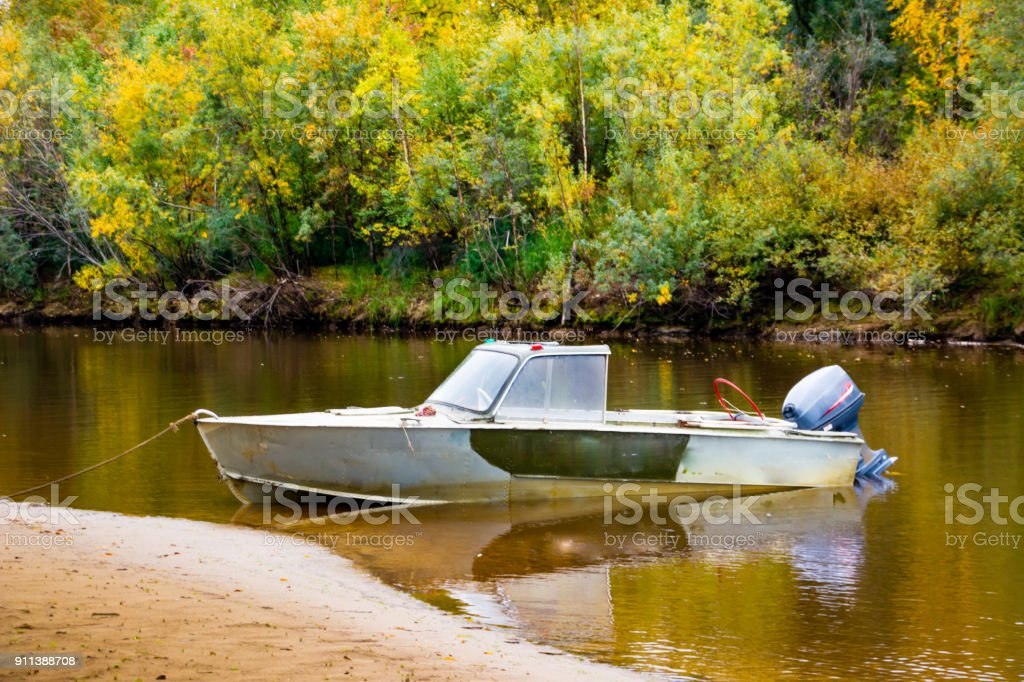 The  fishing boat in the channel Nadym river. stock photo