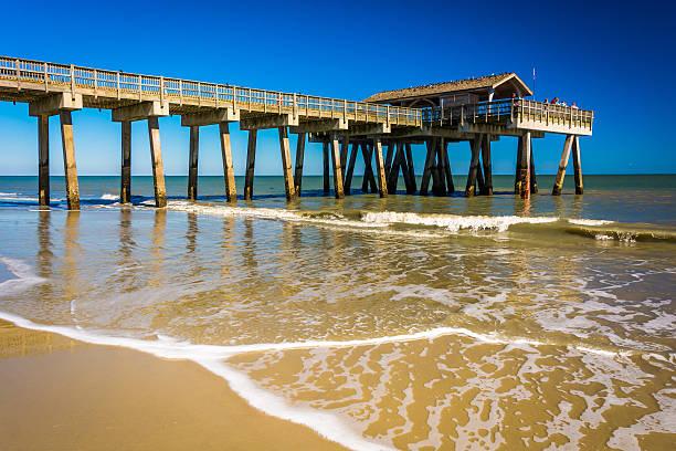 The fishing pier and Atlantic Ocean at Tybee Island, Georgia. stock photo