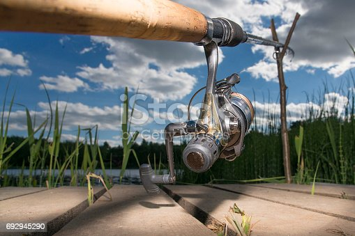 1094918172istockphoto The fishing-rod standing on a support thrown in water for fishing. 692945290