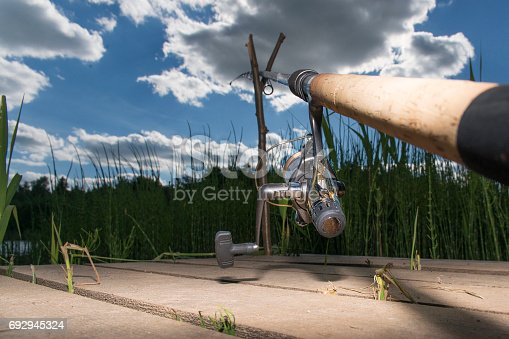 1094918172istockphoto The fishing-rod standing on a support thrown in water for fishing. 692945324