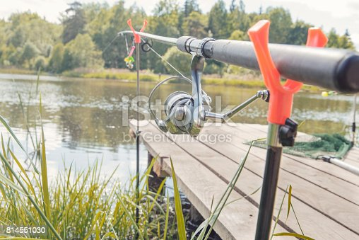 1094918172istockphoto The fishing-rod standing on a support thrown in water for fishing. 814551030