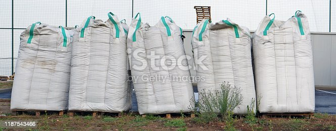 istock The  five big  bags with construction debris is made of a white synthetic sacking  near the unfinished city building 1187543466