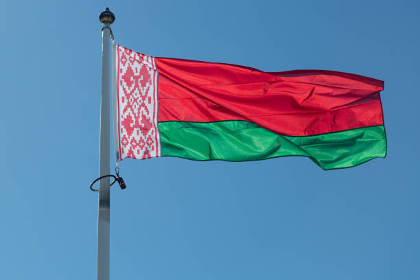 The Flag of Belarus The Flag of Belarus close up with a blue sky. belarus stock pictures, royalty-free photos & images