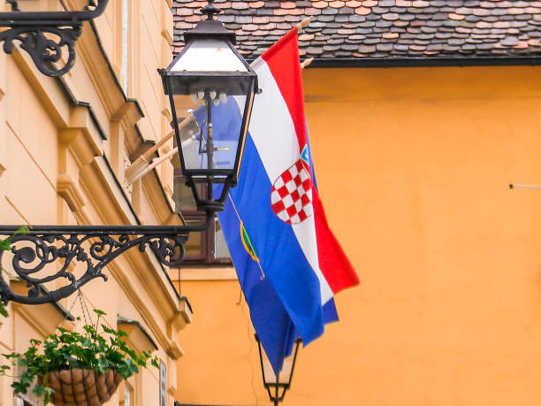 The flag of Croatia displays on window on apartment The image of Croatian flag which is hanged in apartment window in Zagreb, Croatia croatian culture stock pictures, royalty-free photos & images