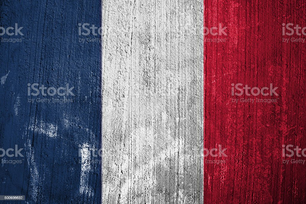 The Flag of France on grunge wall background stock photo