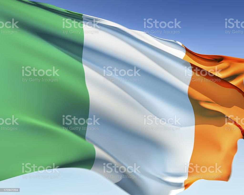The flag of Ireland blowing in the wind stock photo