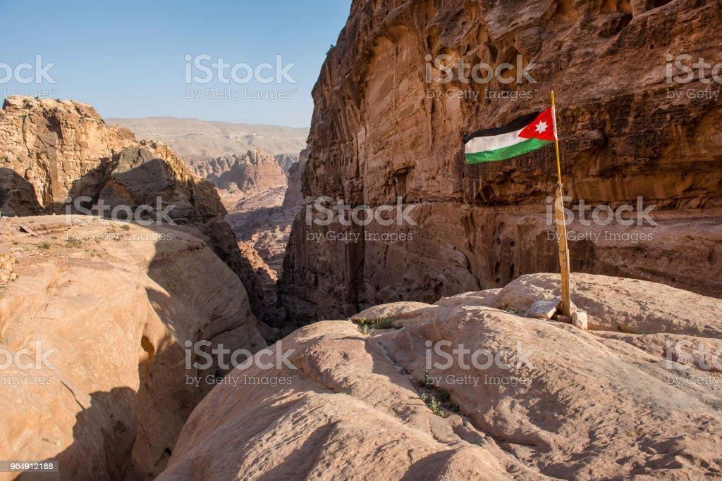 The flag of Jordan in Petra royalty-free stock photo