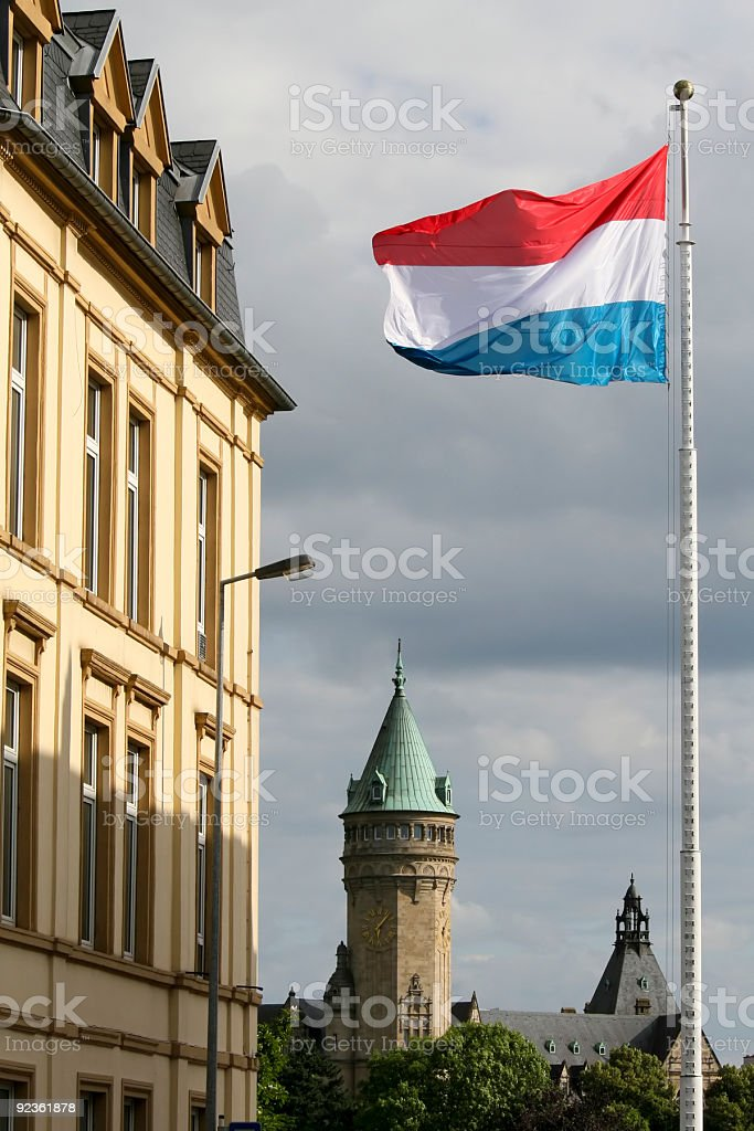 The flag of Luxembourg in the city stock photo