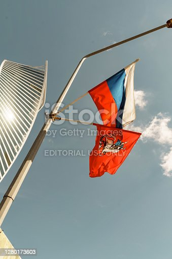 07/01/2020 Moscow, Russia. the flag of russia and the flag of george the victorious against the sky