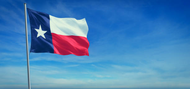 The flag of Texas state USA The flag of Texas state USA blowing in the wind in front of a clear blue sky texas stock pictures, royalty-free photos & images
