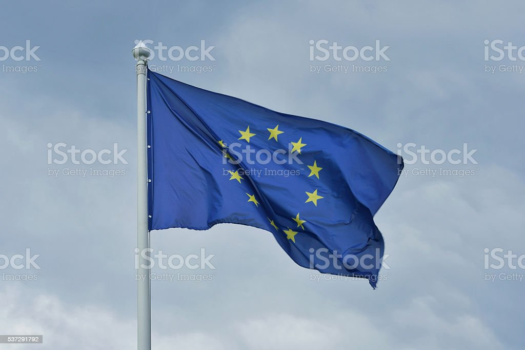 The flag of the European Union flutters on wind. stock photo