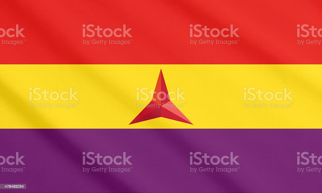 The flag of the International Brigades waving stock photo