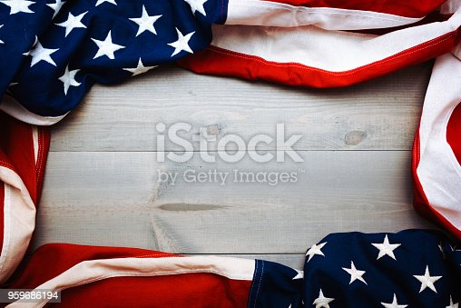 istock The flag of the United Sates on a grey plank background with copy space 959686194