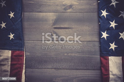 istock The flag of the United Sates on a grey plank background with copy space 959725696