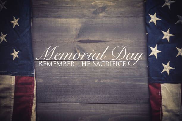 The flag of the United Sates on a grey plank background with memorial day stock photo
