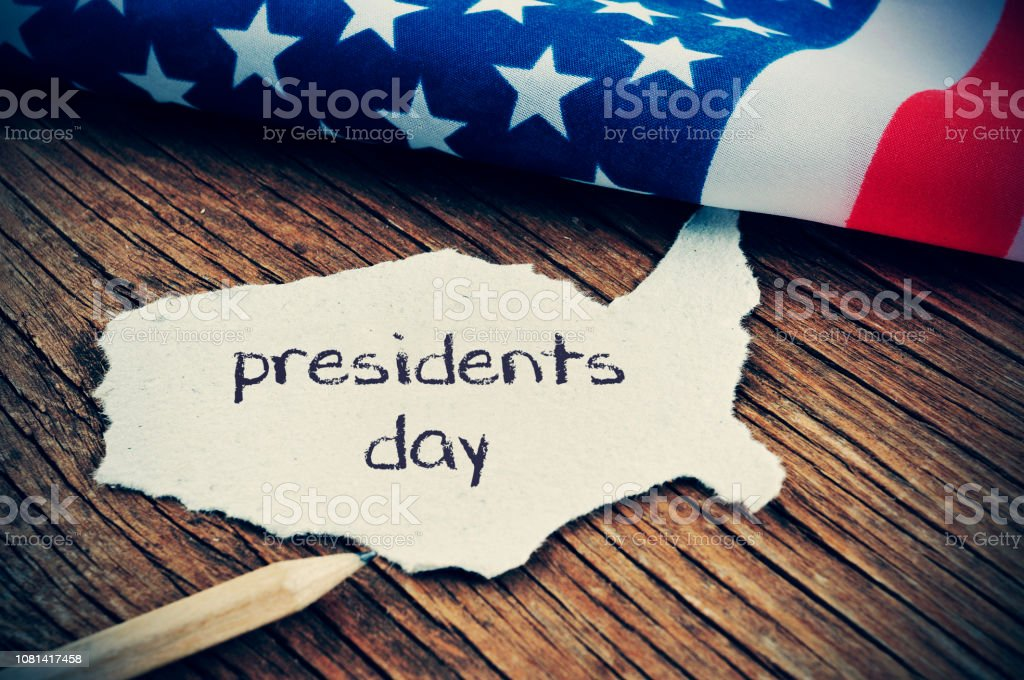 the flag of the US and the text presidents day, vignetted stock photo
